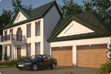 dwie bramy do garażu zamontowane obok siebie model Izoline, kolor okleiny złoty dąb