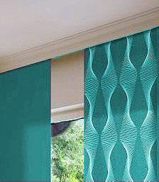 zasłony panelowe tzw. panel track, w kolorze zielonym, materiał jednolity i wzorzysty